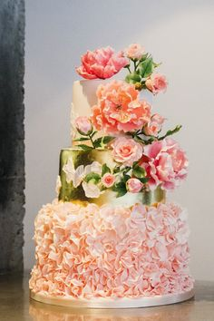 Three tier pink and gold leaf wedding cake with sugar flowers by Little Bear Cakery.
