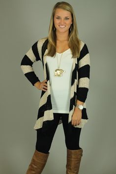 CHEVRON CARDIGAN...EEEEKK...A chevron cardigan, NO WAY! The black and off white color combo makes it easy to pair this cardigan with anything. We love that it's long enough to wear with leggings. The thick stripes give this cardigan an expensive look. You do not want to be caught without this in your closet!!! Lindsay is wearing our perfect layering tank underneath.