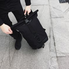 Water-resistant rolltop backpack with padded and secure 15 laptop compartment. Perfect for urban commuting: - Durable waterproof 1000D CORDURA® exterior