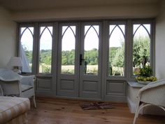 Bifold Door with arch detail in window frames