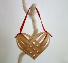 Sweet little DIY woven heart ornament. Slip a little note inside and give to your honey or your kids or your sister, friend, mom, aunt...