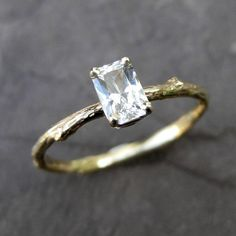 Oh, this is lovely... not only emerald cut, but also has a branch band with a little leaf.  Gorgeous.
