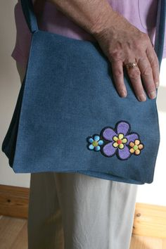 This cool denim handbag harkens back to the age of hippies and flower power. It would be ideal for an unusual birthday or Christmas gift, to