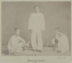 Original Caption: Group portrait of men with cocks, ready for a cockfight. Date Photographed: 1888. Credit: Kern Photography Collection, Museum of Ethnology.