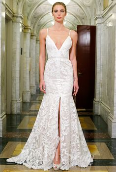How awesome is the high slit on this @vkkny wedding dress? | Brides.com