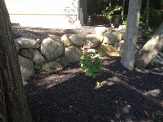 Boulder retaining wall by Bahler Brothers
