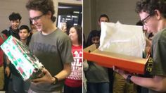 Classmates gift student with two new pairs of shoes when the ones he is wearing is several sizes too small