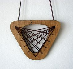 big wooden necklace triangle with cotton strings by psarokokalo. $30.00, via Etsy.