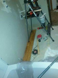 First Pergo flooring board laid into place! Love how warm it looks! Peach Bathroom, Home Appliances, Flooring, Warm, House Appliances, Appliances, Wood Flooring, Floor