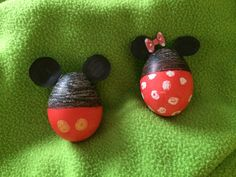 Minnie and Mickey Easter eggs. I colored half with black crayon then took the wax clear crayon for the white dots on the bottom of Minnie and yellow crayon for Mickey. Then dipped it in red half way. I cut out some circles for ears and taped them on.