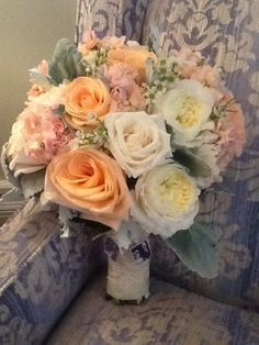 Peaches and cream bouquet with lockets and lace handle. Bayview Florist Wedding Studio, Sayville NY.   www.liweddingbouquets.com