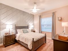This cute bedroom blends sophistication with a bit of fun! The gray accent wall makes the room pop - along with the cute llama friend on the wall. Highland Homes' Shelby model home in Winter Haven, Florida Creative Kids Rooms, Highland Homes, Bedroom Pictures, New House Plans, Florida Home, Wall Treatments, Model Homes, Home Builders, Geometric Shapes