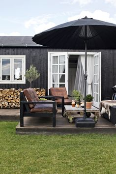 Outdoor Living Ein Sommerhaus in Dänemark How far should you bury your roc in the ground? Outdoor Living Space, Summer House, Outdoor Decor, Patio Umbrellas, Outdoor Lounge, Outdoor Design, Outdoor Spaces, Outdoor Living, House Exterior