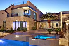 Modern style home with stone and big glass windows. | See more about dream houses, dream homes and rooftop patio.