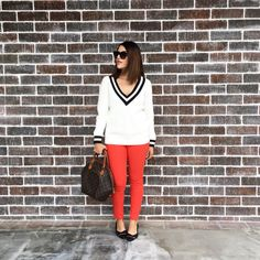 Red pants, black flats, white and black striped sweater, outfit.