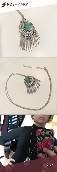 Silver & Turquoise Southwestern Style Necklace Beautiful silver necklace with metal fringe and turquoise-colored stone! Never worn except to model for this listing. Cannot verify that it's sterling as I cannot find a marking anywhere, however I suspect some components may be sterling because it had tarnished slightly from sitting in my jewelry box and cleaned up with silver cleaner! There is some patina on the silver but it only adds to its charm. I do not believe stone is genuine. Pendant…