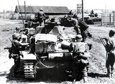 PzKpfw IIIs and IV`s of the 5th Waffen SS Panzer Abteilung , and infantry of the Waffen SS Division Wiking , entering Rostov in July 1942