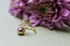Gold butterfly wrap ring for women with a big pearl.