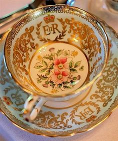 This teacup and saucer were made in 1953 to commemorate Queen Elizabeth II coronation, note the pink roses in the center of the teacup.