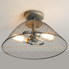 """It's all in the details! The rusty gray zinc chicken wire ceiling light is a great look for farmhouse, industrial or rustic chic decor in the kitchen, hallway, office or bedroom. Pair it with our vintage edison bulbs for extra character. 8""""Hx15""""W (2) 60W max, medium base sockets.5"""" canopy."""