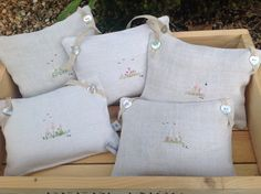 Lavender bags by T&Linen. Larger than sachets with embroidery & ribbon or tape from each corner, rather than central. Beautiful.