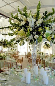 A Magnificent Centerpiece Accentuates this Chartreuse ,Crystal & White Toned Tablescape
