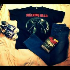 """Walking dead T-shirt Walking dead black T-shirt! Image of """"walkers"""" black/grey/white .word printed in red. (I think I actually payed more than 30, but its been awhile.) Loved well and in Perfect condition!As a huge fan, I Wouldn't be getting rid off this if it still fit me, only worn a couple of times. 100% cotton (This listing only includes walking dead T-shirt) *pants in these pictures are for sale in separate listings* Tops Tees - Short Sleeve"""