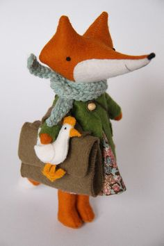 Image of Bigger fox EidaMini Eida is just 18cm (7inches) tall. Needs assistance with standing up on her own.Eida can sit, move her little arms and legs.Ms fox comes with 3 dresses, felt coat, knitted scarf
