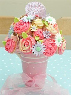 Cupcake bouquets! So cute for a center piece and dessert at a wedding