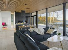 Simply articulated, meticulously crafted weighted volumes in timeless materials of cherry, maple and travertine create texture in elevation while appearing airy as the nestle between panes of glass. Prefab Homes, Log Homes, Courtyard House, Small House Design, Cottage Homes, House In The Woods, Traditional House, Home Decor Inspiration, My Dream Home