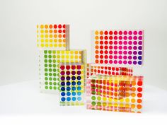 Rainbow clear puzzle - 14x8.5 cm (5.5x3.3 in) clear cast acrylic puzzle with translucent dots encapsulated in the centre of each piece. Hand made in UK. It takes a while...