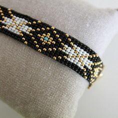Woven bracelet black, gold, white and a hint of blue Loom Bracelet Patterns, Seed Bead Patterns, Bead Loom Bracelets, Woven Bracelets, Jewelry Patterns, Handmade Bracelets, Beading Patterns, Handmade Jewelry, Colorful Bracelets