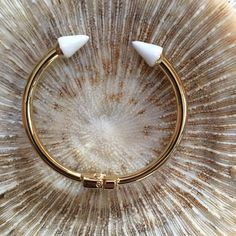 White Enamel Spike Bracelet by T & J Designs Gold Bracelet with White Enamel Tips.  Material  Content:  Base Metals, Resin.  Lead Free, Nickel Free.  Beautiful Quality.  Stock Photos courtesy of T & J Designs. T&J Designs Jewelry Bracelets