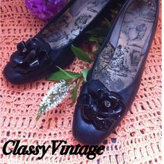 Vintage black Lester shoes.HP Black leather with patent leather flowers on top of shoe. Love the style of the heel. These are vintage and have been used. No real issues - normal signs of wear - no scrapes or lacking of color. 13/4 inch heel. Lester Shoes