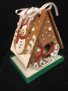 Happy Snowman Gingerbread House.