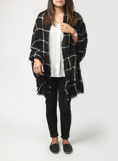 Unsure of how to rock the blanket scarf trend? Check out 9 easy and stylish ways to wear a blanket scarf.