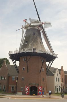 Vermeer Windmill in Pella, Iowa - Twenty-four buildings surround a courtyard with red brick walkways, blossoming trees, and beautiful tulip gardens. Some of the buildings have been on the site for more than 150 years; others were moved in and restored.