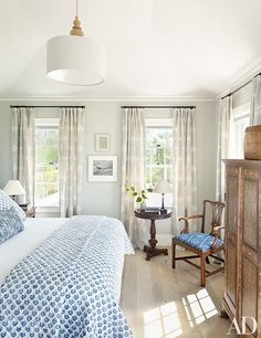 A classic blue-and-white bedspread adds a beachy feel to this Nantucket guest bedroom. | archdigest.com