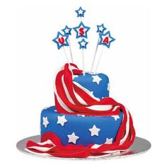 Soaring Spirit! Cake - Give this red, white and blue cake room to shine on your serving table. Top a two-layer cake with fondant fireworks raised high with Lollipop Sticks.