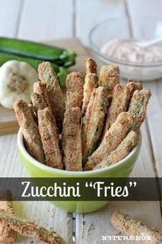 zucchini fries 2 zucchini, cut in 4-in sticks 1/3 c flour 2 eggs, beaten 1 c season bread crumbs  Preheat oven 400 F. Coat cooling rack w nonstick spray and place on baking sheet.  one at a time, dredge zucchini in flour, dip into eggs, then dredge in bread crumbs, pressing to coat. bake until golden brown, about 15-18 min