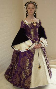 Young lady wearing a Elizabethan style gown and hood.