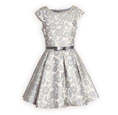 has full swing style skirt. Hidden zip back. Above knee length. Silver belt has bow with rhinestone accents. Made exclusively for THE WOODEN SOLDIER.