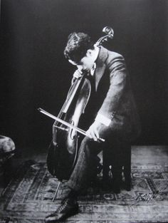 I knew Charlie Chaplin played the violin, but he looks like a whole different soul playing cello.