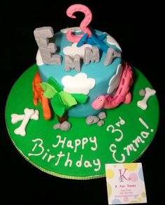 Blue Pterodactyl & Pink and Orange Dinosaurs Birthday Cake.