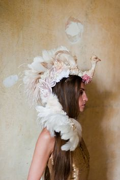 White Peacock Feather Headpiece; Ft in Matthew Williamson's Bruton Street Store with his Snow Drop Printed Silk Gown. Also ft in Vanity Fair