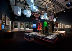 """This exhibition design is so inspiring and influential in future design work i do. I love how the bright strobe lights work to create a very distinct """"rock"""" feel. Items on display include more than 60 stage costumes, including the Ziggy Stardust bodysuits designed by Freddie Burretti in 1972, Kansai Yamamoto's creations for the 1973 Aladdin Sane tour and a Union Jack coat designed by Alexander McQueen for the cover of the 1997 album Earthling.'"""