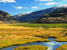 Red Rock Ranch, Wyoming Beautiful landscape of valley and stream www.rusticvacations.com