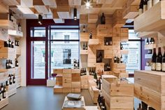 """This original looking store was designed by Swiss firm OOS for Albert Reichmuth (a famous wine company), and is located in Zurich. The classy wine showroom also known as """"LA GALERIE DU VIN"""" was especially developed for wine lovers and is not only a place for sale, but also a gathering area for the """"connoisseurs"""". …"""
