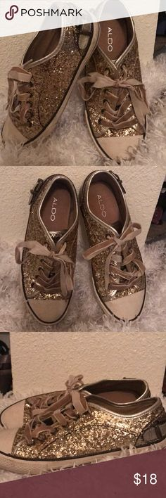 "Aldo gold sparkle sneakers ✨ These are ADORABLE. Gold, sparkly, metallic sneakers are the ""it"" item this season! Aldo brand. Sides feature cute buckle detail. Laces are velvet. Reposhing only because they didn't quite fit. Some signs of wear and a little of the velvet on parts of the laces is a little worn. Sad to see them go! Aldo Shoes Sneakers"