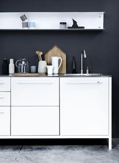 White modern kitchen and black wall